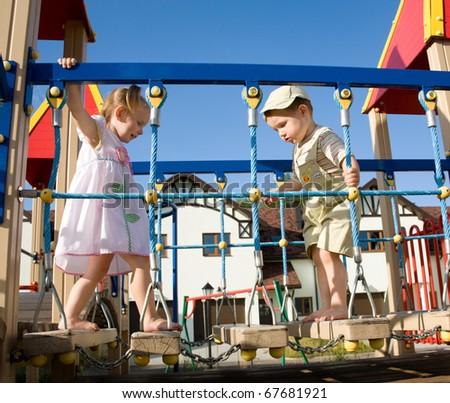 Little children on playground - stock photo