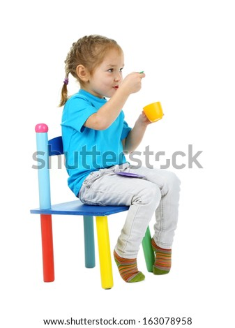 Little children playing with colorful tableware isolated on white