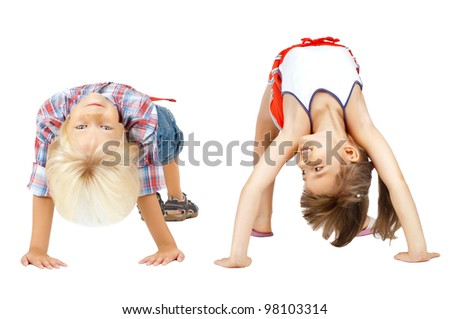 little children  stand head over heels and smile, on white background, isolated - stock photo