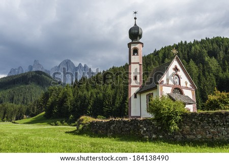 Little Church over forest and Odle mounts in the Dolomites, during Summer