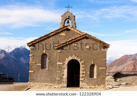 Little church with clear blue sky - stock photo