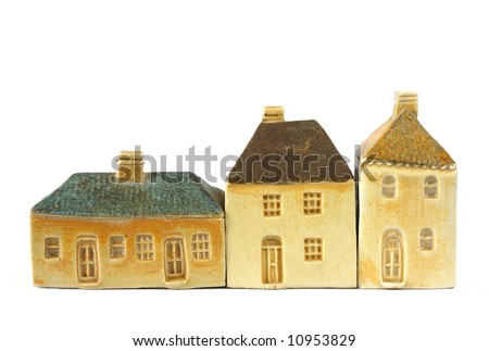 Little clay houses.  These are models of 19th century English houses, isolated on white. - stock photo