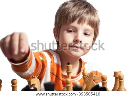 Little clever boy thinking about chess - stock photo