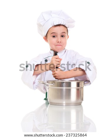 Little confused boy chef with ladle stirring in the pot isolated on white