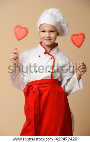 Little cook girl tasting cookies