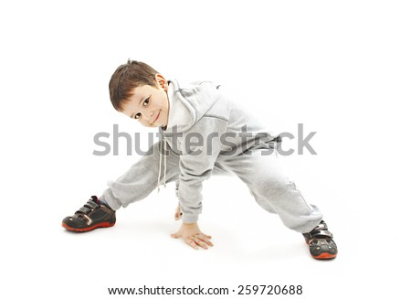 Little cool hip-hop boy in dance. Isolated on white background  - stock photo