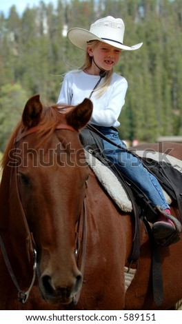 Little Cowgirl on Horseback #2 - stock photo