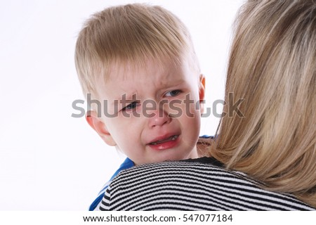 little crying boy on moms shoulder