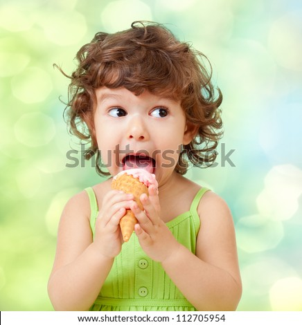 little curly girl with ice cream on colorful background - stock photo