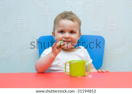 little, cute baby boy drinking milk with a straw - stock photo
