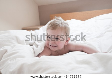 little cute baby boy on the bed