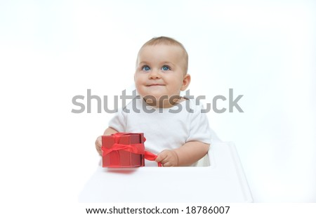 little, cute baby boy with gift box, on white