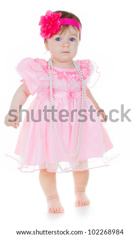 little cute baby girl doing first steps - stock photo