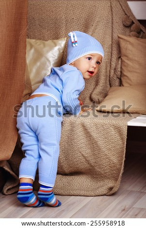 Little cute baby in pajamas, shot in home interior