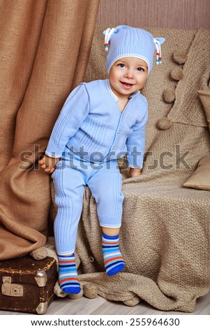 Little cute baby in pajamas, shot in home interior - stock photo