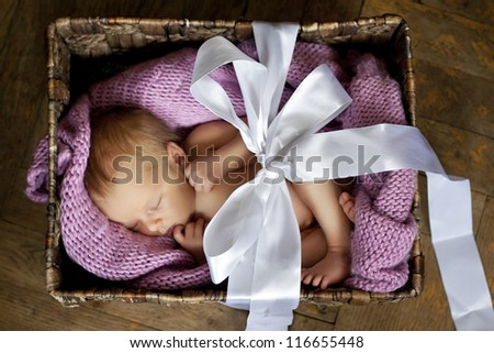 little cute baby in the box with a gift bow - stock photo