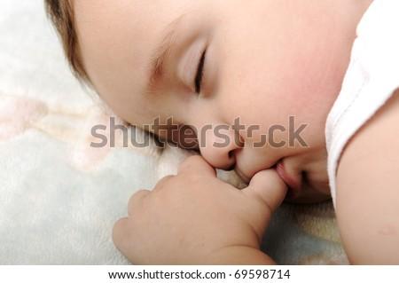 Little cute baby sleeping - stock photo