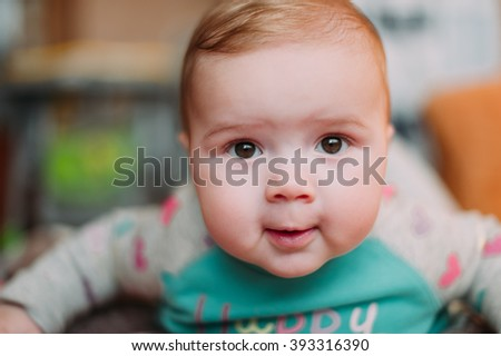little cute baby toddler on carpet close up smiling adorable happy emotional playing at home