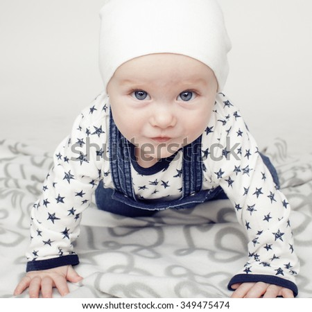 little cute baby toddler on carpet isolated close up, adorable kid - stock photo