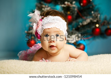 little cute baby with christmas tree - stock photo