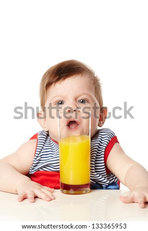 little cute baby with glass of juice
