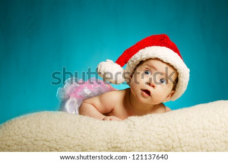 little cute baby with santa hat looking up - stock photo