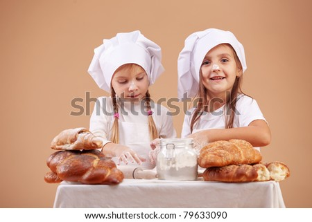 Little cute bakers studio shot - stock photo