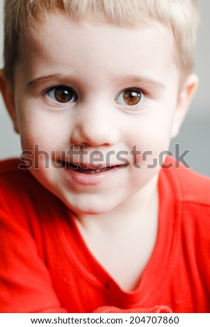 little cute blond boy toddler happy smile looking at camera closeup portrait  - stock photo