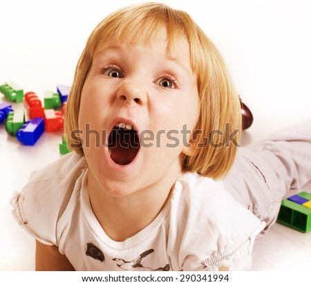 little cute blond girl emotional screaming in camera on white background isolated - stock photo