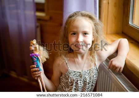 little cute blond girl play with her dall - stock photo