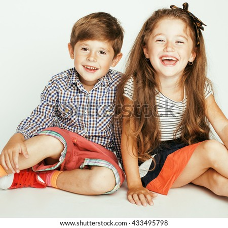 little cute boy and girl hugging playing on white background, happy family smiling twins - stock photo