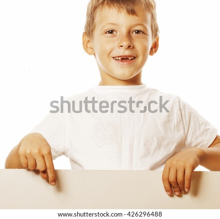 little cute boy holding empty shit to copyspace isolated close up gesturing smiling - stock photo
