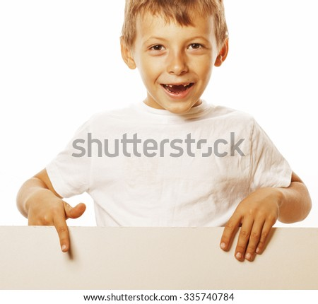 little cute boy holding empty shit to copyspace isolated close up gesturing smiling adorable - stock photo