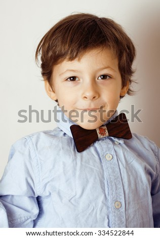 little cute boy in bowtie smiling, making funny faces, stylish casual kid