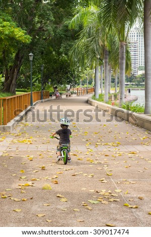 Little cute boy on a bicycle - stock photo