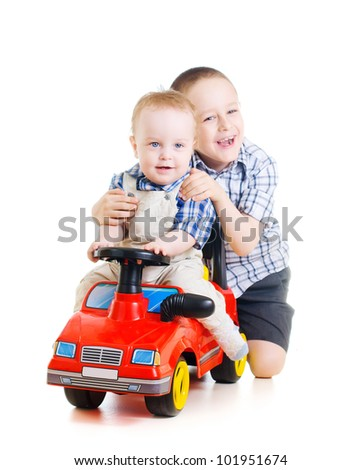 little cute boy playing with a toy car with elder brother - stock photo