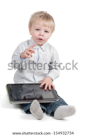 Little cute boy sitting with tablet computer - stock photo