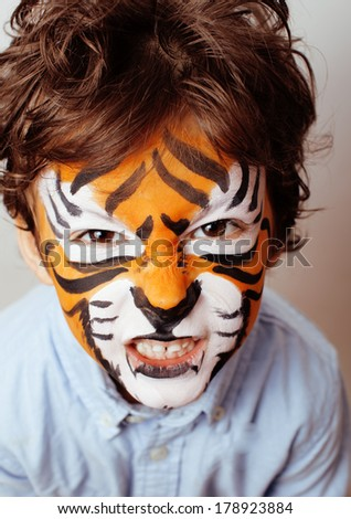 little cute boy with faceart on birthday party close up - stock photo