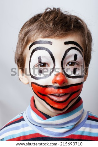 little cute boy with facepaint like clown, pantomimic expressions close up isolated - stock photo
