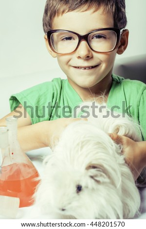 little cute boy with medicine glass isolated wearing glasses smiling close up - stock photo