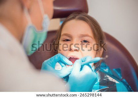 Little cute caucasian girl during visit in dental office - stock photo