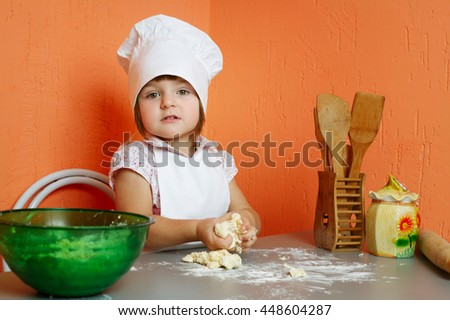 little cute chef cooking biscuits