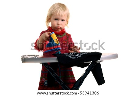 little cute child ironing the clothes with iron toy