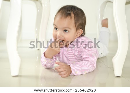Little cute funny boy with lollipop candy - stock photo