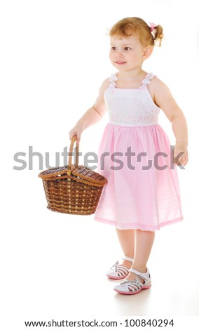 little cute girl holding a picnic basket on white background - stock photo