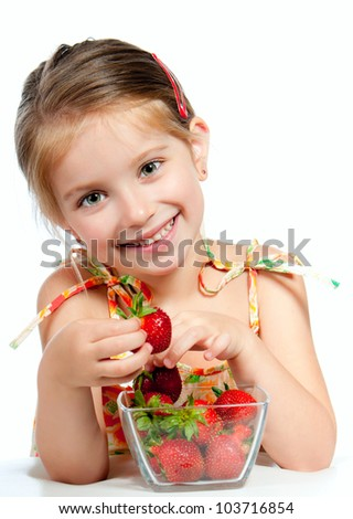 little cute girl holding a strawberry, isolated on white - stock photo