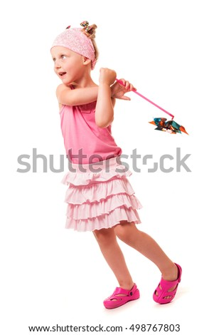 Little cute girl holding a windmill isolated on white background.