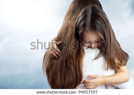 little cute girl hugging her mother - stock photo