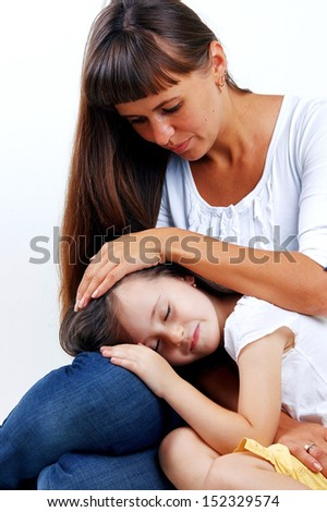 Little cute girl hugging her mother with long hair - stock photo