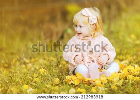 Little cute girl in autumn day - stock photo